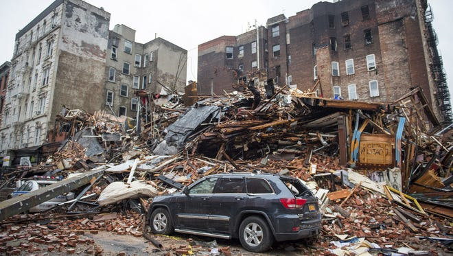 In this March 27, 2015 file photo, a pile of debris remains at the site of a building explosion in the East Village neighborhood of New York. The Manhattan district attorney and others make an announcement on Thursday, Feb. 11, 2016,  about the investigation into the March 2015 explosion that killed two people and leveled three buildings in the East Village.