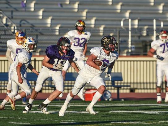 Foothill High School's Pat Blake intercepts the ball