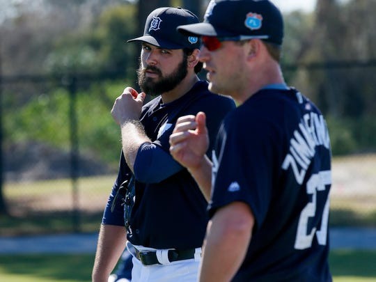 New Tigers pitchers Michael Fulmer and Jordan Zimmermann take a break in camp Friday.