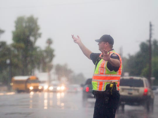 A Phoenix police officer controls traffic during the