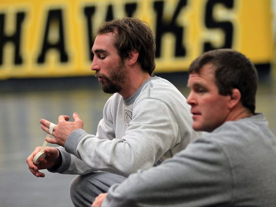Former Hawkeye Daniel Dennis sits with Iowa assistant coach Terry Brands before practice at Carver-Hawkeye Arena on March 31. Dennis heads into the U.S. Olympic Wrestling Team Trials ranked third in freestyle at 125.5 pounds (57 kilos).