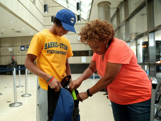 DelShawn Fowler, 18, of Detroit, with his mentor Renee