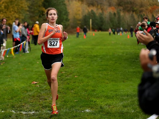 Sprague's Ginger Murnieks finishes first in the Greater Valley Conference championship girl's 5K race at the Crystal Lake Sports Park in Corvallis on Wednesday, Oct. 26, 2016. Sprague's Ginger Murnieks finished first.