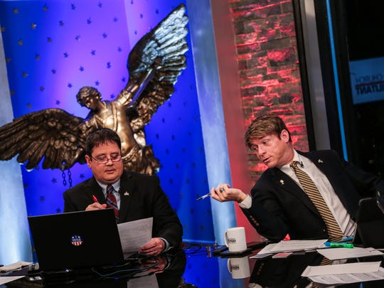 Panelists Bradley Eli, left, and Michael Voris chat before a live TV broadcast recording on Tuesday, Jan. 31, 2017, at the Church Militant studios in Ferndale.