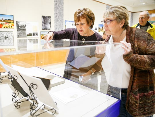 Jane Evans, left, and Anne Miller, right, look at the