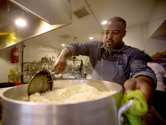 Chef and owner Max Hardy prepares sweet potato and coconut risotto during  at the River Bistro in Detroit.