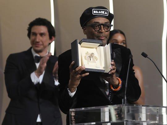 Director Spike Lee holds aloft the Grand Prix award