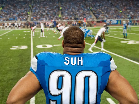 Lions defensive tackle Ndamukong Suh watches from the