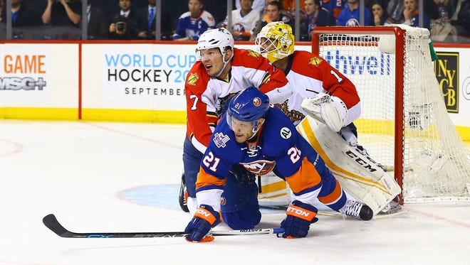 Defenseman Dmitry Kulikov knocks down Kyle Okposo of the Islanders during the first round of the Stanley Cup playoffs in April. The Sabres obtained Kulikov from the Florida Panthers in a trade on Saturday.