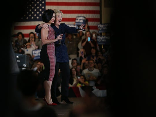 Presidential hopeful, Hillary Clinton and musical artist, Demi Lovato take the stage together at a Clinton campaign event at the Iowa Memorial Union in Iowa City, on Thursday, Jan. 21, 2016.
