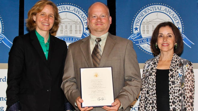 North High School teacher Corey Andreasen, center, accepts his Presidential Awards for Excellence in Mathematics and Science Teaching certificate last week in Washington, D.C. with U.S. Chief Technology Officer Megan Smith, left, and Director of the National Science Foundation, France Cordova.