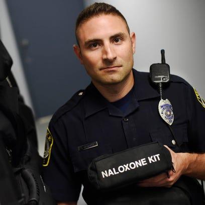 York Area Regional patrol officer Josh Crimmel holds