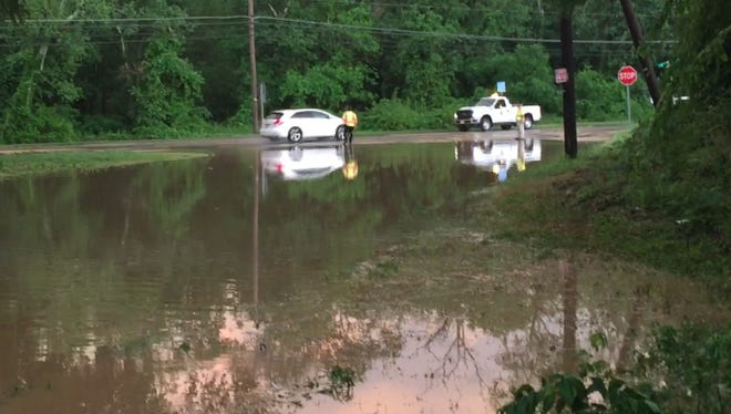 South Brewster Road was blocked to traffic Friday evening due to flood waters, though South Lincoln Avenue was open to vehicles willing to try it.