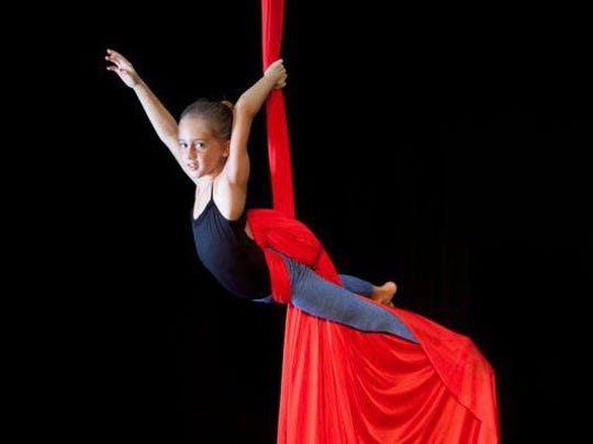 """This young Performing Arts Academy of Jupiter student is taking a class in """"Silks."""""""