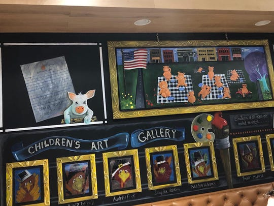 A wall is dedicated to children's art at Smokin J's.