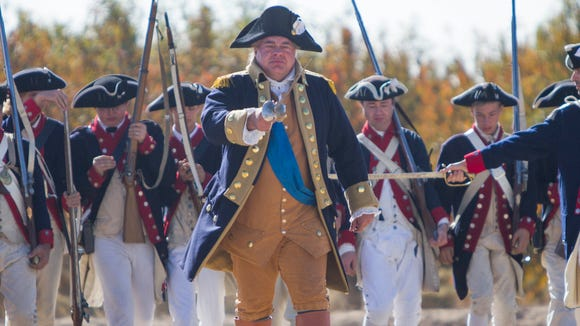 General George Washington leads his colonist against the British Red Jackets during the American Heritage Festival battle reenactment at Schnepf Farms, Sunday, November 23rd, 2014, in Queen Creek, Ariz.