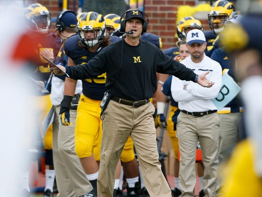 Michigan head coach Jim Harbaugh questioning why there