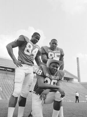 Receiver Gene Washington (84), defensive end Bubba Smith (95) and safety Jess Phillips (38) — all from Texas — were starters for MSU during their 19-1-1 run between the 1965 and '66 seasons.