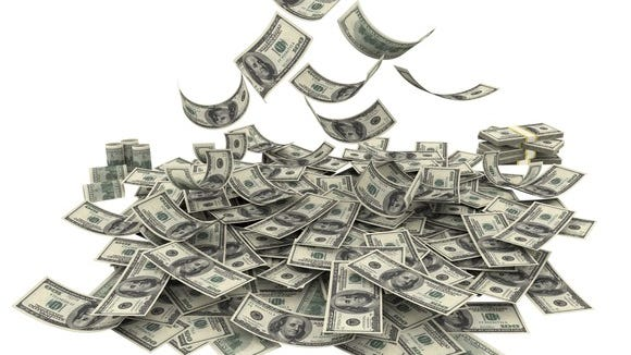 Money falling into a pile.