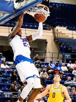 Tennessee State's Christian Mekowlulu goes up for a dunk in game against Lipscomb.