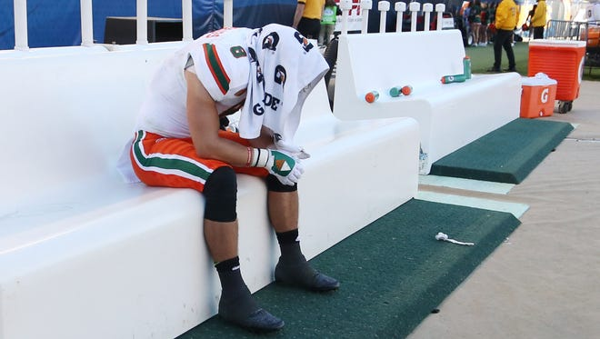 Miami wide receiver Braxton Berrios sits on the bench after the Hurricanes lost to PIttsburgh on Friday.