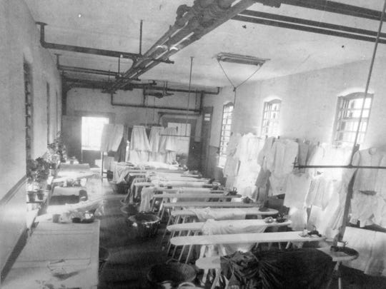 Early photo of the laundry and ironing room at the Indiana Women's Prison. Date unknown.