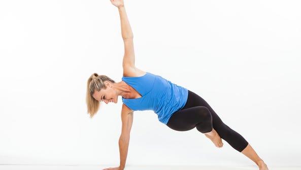 Jessica Smith demonstrates a side plank balance. Smith's