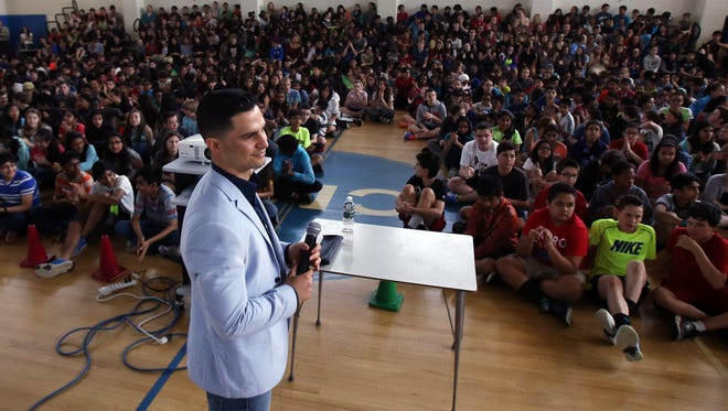 Richie Contartesi, an Ole Miss walk-on football story who wrote a memoir about his experience, 'In Spite of the Odds.' He is now tours as a motivational speaker and spoke to Central Middle School students about his story.  May 12, 2016. Parsippany, N.J.