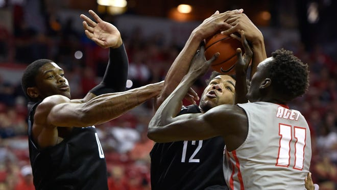 Nevada's Elijah Foster (12) competes for a rebound against New Mexico's Obij Aget during their Mountain West Tournament game last season.
