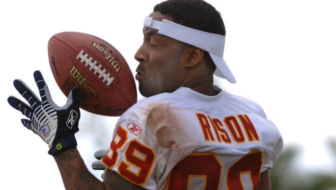 Ex-NFLer Andre Rison grabs  a pass during an alumni game before the 2006 Pro Bowl in Honolulu. A judge in Michigan has signed an arrest warrant for the former Spartans receiver, who is accused of violating his probation in a child support case.