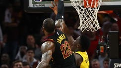 LeBron James blocks Victor Oladipo in the closing seconds