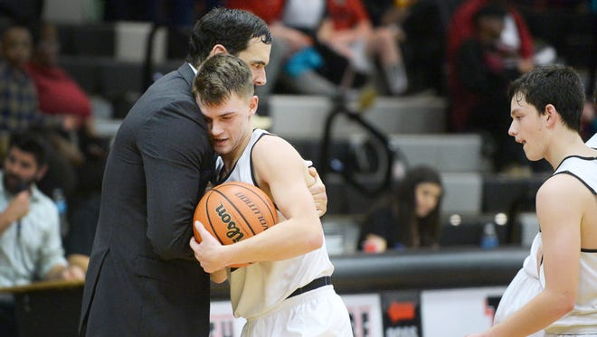 David Elkins and North Buncombe boys basketball coach David Rutledge embrace after Tuesday night's 57-42 home win over Asheville High in Weaverville.