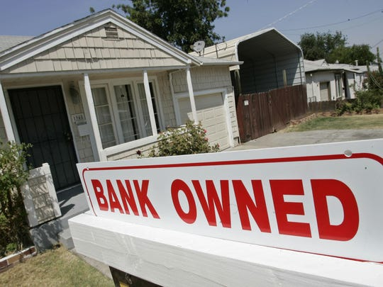 This Aug. 14, 2007, file photo shows a sign of a house under foreclosure in Antioch, Calif. As home values plummeted after the housing bubble burst in 2007, many borrowers with exotic types of loans were stuck, unable to refinance as lenders began to tighten their lending criteria. That set the stage for cascading mortgage defaults.