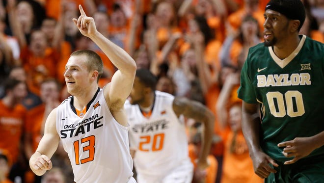 Oklahoma State guard Phil Forte (13) celebrates a 3-point shot in front of Baylor forward Royce O'Neal (00) during the second half of an NCAA college basketball game in Stillwater, Okla., Tuesday, Jan. 27, 2015.