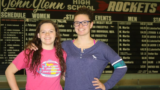 Westland John Glenn junior swimmers Kera Sells (left) and Sidney Aloisi have excelled in the pool for the Rockets this season.