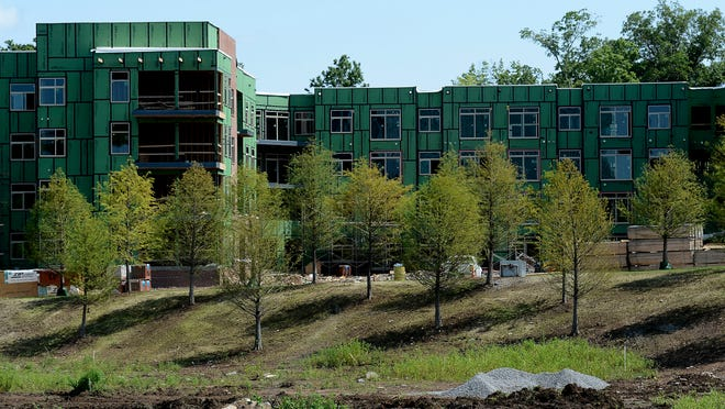 Apartment buildings are being built near the Franklin Park development, which also is under construction near McEwen Drive and Interstate 65 in Franklin.