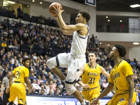 Monmouth's Micah Seaborn drives to the basket in front of a sellout crowd at OceanFirst Bank Arena in West Long Branch.