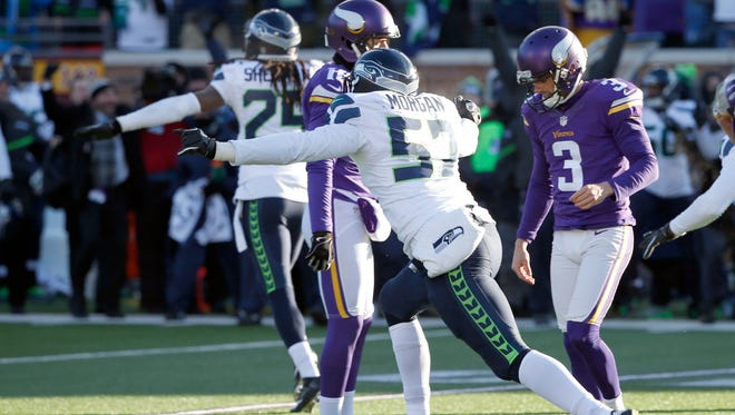 Minnesota Vikings kicker Blair Walsh (3) hangs his head after missing a 27-yard field goal during the final seconds of Sunday's NFC Wild Card loss to the Seattle Seahawks. Seattle rallied to defeat Minnesota, 10-9, and will face the top-seeded Carolina Panthers next Sunday.