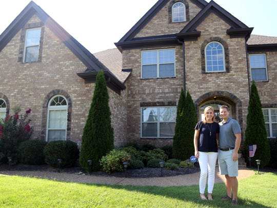 Rachel and Nick Porco stand inside their home in Brentwood.