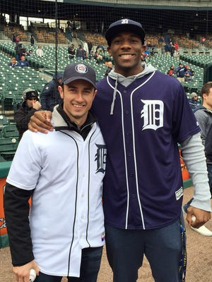 Race car driver Dane Cameron, left, and former Michigan wide receiver Devin Funchess threw out first pitches at today's Detroit Tigers game at Comerica Park.
