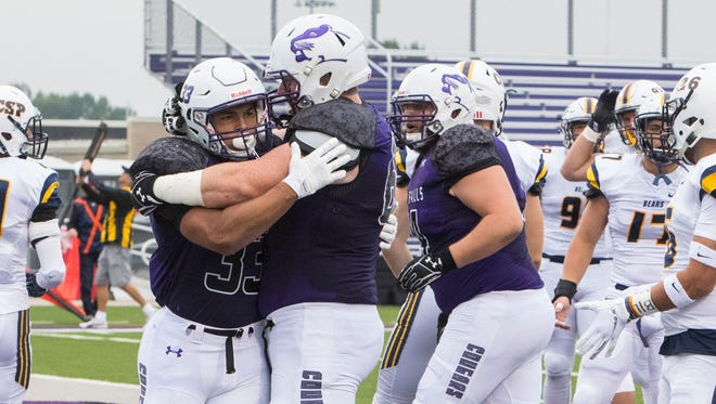 University of Sioux Falls Gabriel Watson (33) celebrates with teammates after scoring a touchdown against Concordia University, St. Paul on Thursday, Aug. 30, 2018 at Bob Young Field in Sioux Falls, S.D.
