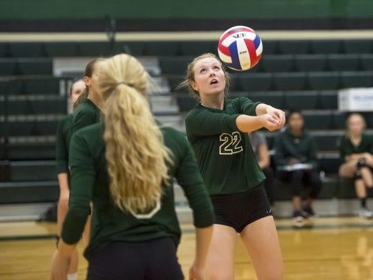 Jenna Mongold and the James Buchanan girls volleyball