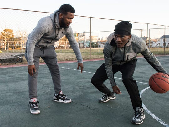 Hayden Frazier, right, works on a dribbling drill with