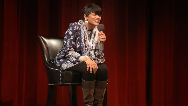 Jae Birdie Fae, a community connector and urban creative, talks about the reality of being a single parent during the Cincy Storytellers event at The Carnegie, in Covington on Wednesday evening. The night was focused on the topic of parenthood.