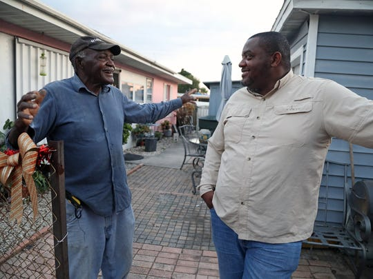 James Sheard, left, talks with son Curt about the early days of City View Park, the name of the subdivision where the Sheards and other African-Americans settled in the 1960s and 1970s, not knowing the City of Fort Myers was operating a dump for toxic waste from its water treatment plant. The Sheards and other neighbors will be attending a city workshop Thursday to hear and ask questions about the results of a first phase environmental assessment showing higher than acceptable levels of arsenic on and off the site.