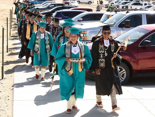 Kyra Capitan, left, and Tristan Joe lead the Navajo