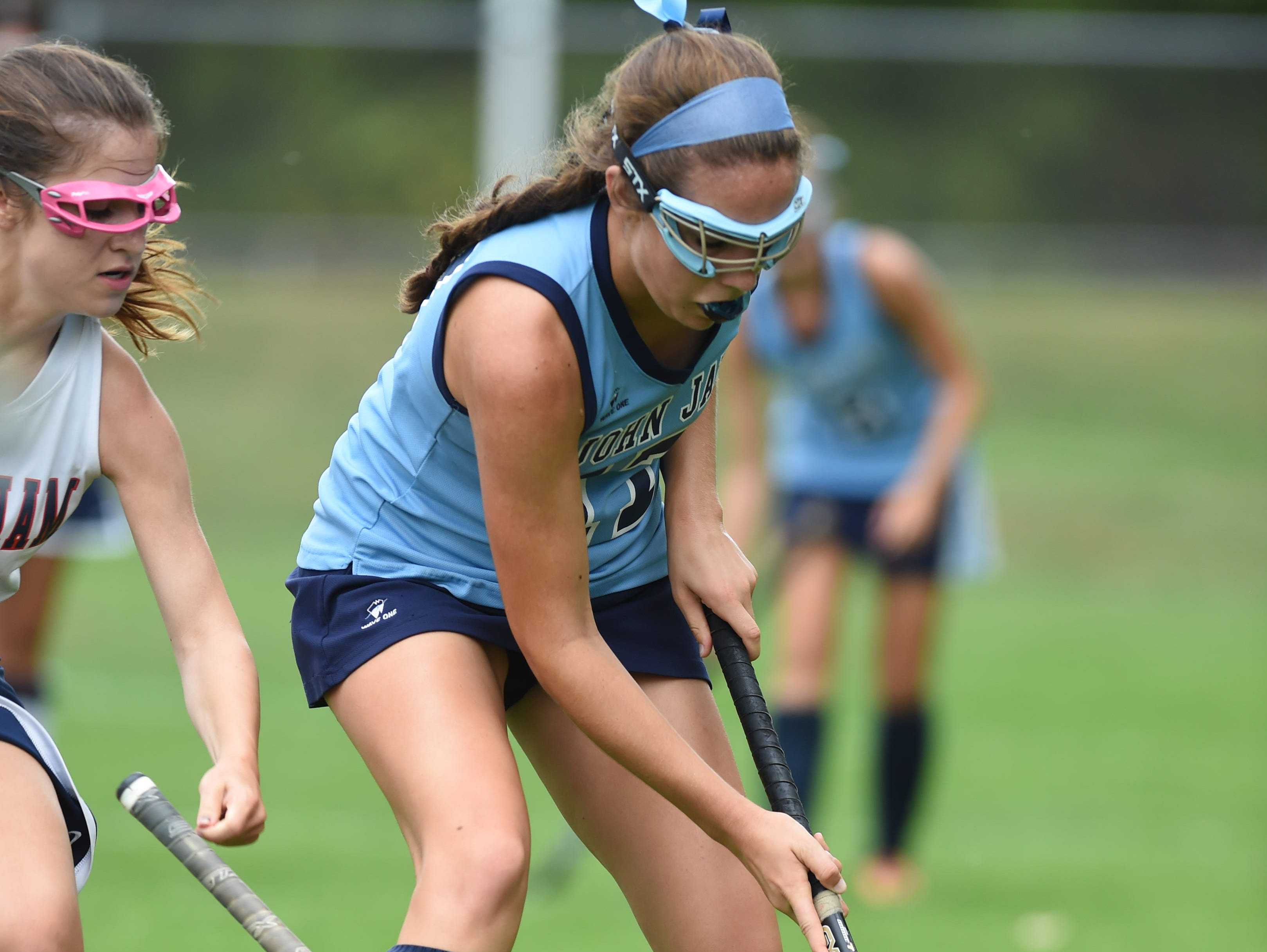 John Jay High School's Jenna Croce moves the ball during a field hockey game against Roy C. Ketcham on Sept. 29.