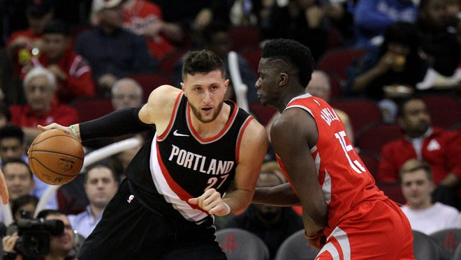 Portland Trail Blazers center Jusuf Nurkic (27) handles the ball in the post as Houston Rockets center Clint Capela (15) defends during the third quarter at Toyota Center.
