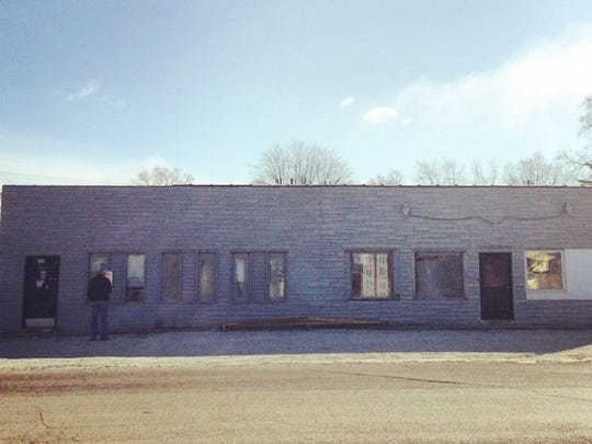 When John and Lisa Schmitz bought this building in Mars Hill, it was stacked with trash and required a major renovation.
