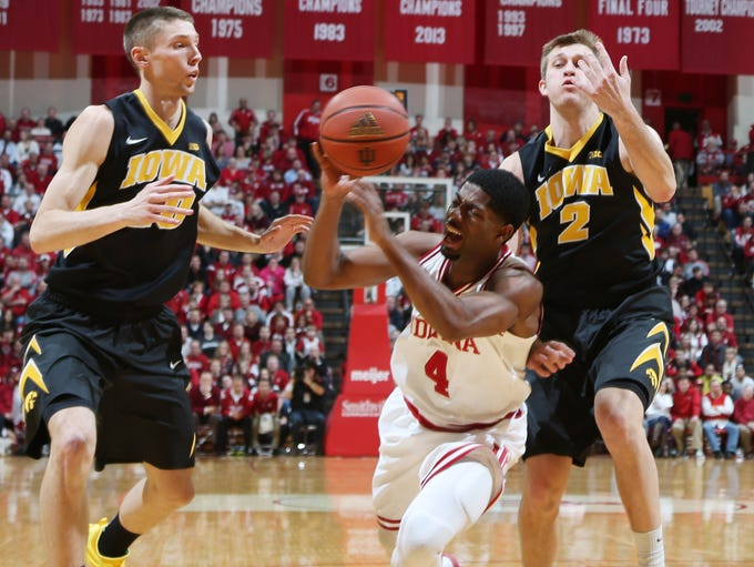 Indiana Hoosiers guard Robert Johnson (4) gets fouled